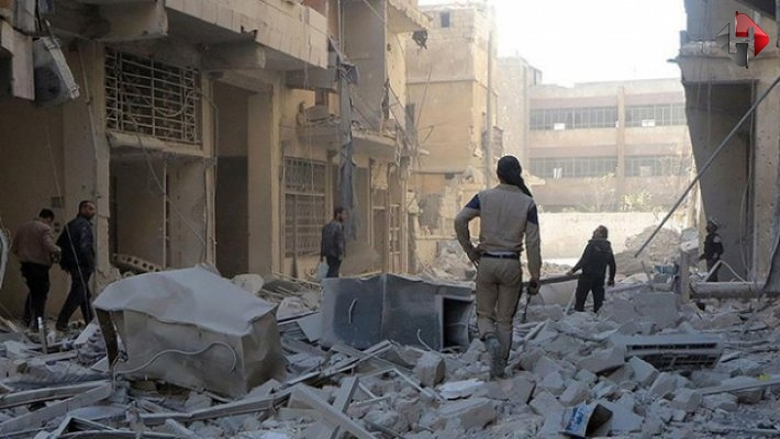 Halep'te yönetim karşıtlarının denetimindeki bölgeye hava saldırısı