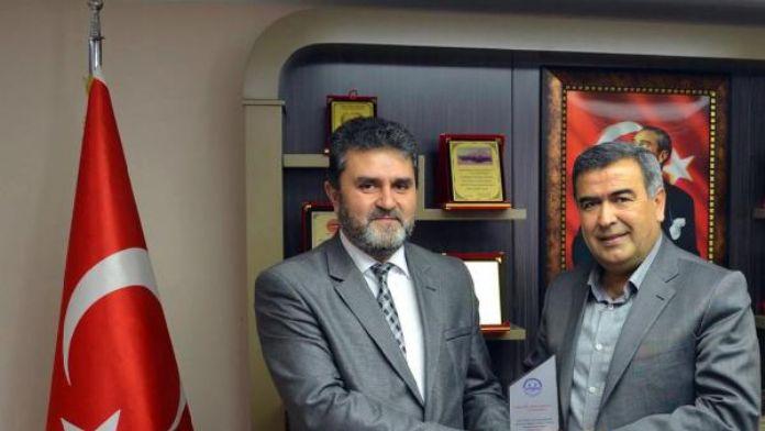 Müftüden, CHP'li başkana plaket