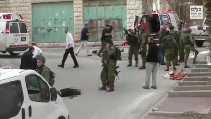 İsrail askeri yaralı halde yerde yatan Filistinliyi başından vurarak infaz etti