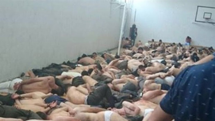 Jandarma Genel Komutanlığı Baskını Esnasında Yakalanan Darbeci Askerler Spor Salonunda soyundurulup bekletiliyor